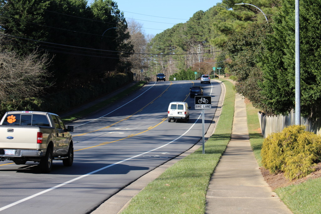 Well-designed bike lane. This wide bike lane leaves plenty of room for maneuvering. The motor vehicle lane is also wide and can accommodate bus and truck traffic while still leaving plenty of clearance between motorist and bicyclist traffic. Lake Pine Drive, Cary, NC. Photo: Steven Goodridge.